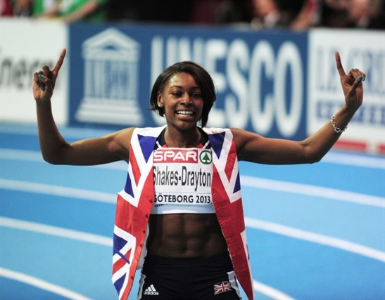 Perri celebrating her 'biggest accomplishment so far...where I came home with two gold medals. That was amazing.'
