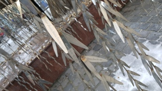The names of the dead are engraved on each metal 'leaf'. Heartbreaking.
